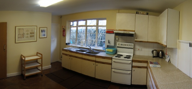 sink by window, cooker, cupboards